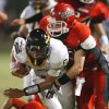 Madill\'s Spencer Bond (8) carries and Purcell\'s Andrew Gray (17) makes the tackle in high school football as Madill plays at Purcell on Thursday, Oct. 1, 2010, in Purcell, Okla. Photo by Steve Sisney, The Oklahoman