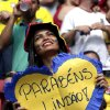 A Colombian supporter holds a sign saying \'Congratulations Handsome\' before the group C World Cup soccer match between Colombia and Ivory Coast at the Estadio Nacional in Brasilia, Brazil, Thursday, June 19, 2014. (AP Photo/Marcio Jose Sanchez)
