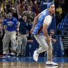 Cameron Rodriguez reacts after hitting the MidFirst Bank $20,000 half-court shot during an NBA basketball game between the Oklahoma City Thunder and the Denver Nuggets at Chesapeake Energy Arena in Oklahoma City, Monday, Nov. 18, 2013. Photo by Nate Billings, The Oklahoman