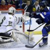 St. Louis Blues\' Ryan Reaves, right, scores past Dallas Stars goalie Kari Lehtonen, of Finland, during the second period of an NHL hockey game Friday, April 19, 2013, in St. Louis. (AP Photo/Jeff Roberson)
