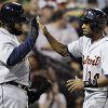 Photo -   Detroit Tigers' Austin Jackson, right, celebrates with Prince Fielder after scoring on a single hit by Miguel Cabrera during the fifth inning of a baseball game against the Chicago White Sox in Chicago, Wednesday, Sept. 12, 2012. (AP Photo/Nam Y. Huh)