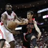Chicago Bulls\' Kirk Hinrich (12) tries to pass the ball around Houston Rockets\' James Harden during the first half of an NBA basketball game Wednesday, Nov. 21, 2012, in Houston. (AP Photo/Pat Sullivan)