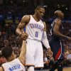 Oklahoma City Thunder\'s Russell Westbrook (0) helps Kevin Martin (23) up after a shot and foul as the Oklahoma City Thunder play the Atlanta Hawks in NBA basketball at the Chesapeake Energy Arena in Oklahoma City, on Sunday, Nov. 4, 2012. Photo by Steve Sisney, The Oklahoman