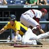 Photo -   Kent State's George Roberts scores on a single by Sawyer Polen, as South Carolina catcher Grayson Greiner looks for the ball, in the second inning of an NCAA College World Series elimination baseball game in Omaha, Neb., Thursday, June 21, 2012. (AP Photo/Dave Weaver)