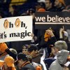 Baltimore Orioles fans hold signs during Game 1 of the American League division baseball series between the Orioles and the New York Yankees on Sunday, Oct. 7, 2012, in Baltimore. (AP Photo/Patrick Semansky)