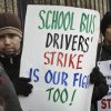 FILE- In this Jan. 17, 2013 file photo, striking school bus drivers walk a picket line outside the Atlantic Express school bus facility in the Queens borough of New York. Leaders of school bus drivers\' union, Local 1181 of the Amalgamated Transit Union, are ending their month long strike in New York City, Friday, Feb. 15, 2013. The strike was suspended a day after five Democratic mayoral candidates sent a letter to the union asking drivers to return to work, promising that if elected, they will revisit the job security issue fueling the strike. (AP Photo/Bebeto Matthews, File)