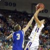 Weleetka\'s Jackson Frye shoots a lay up over Glencoe\'s Kagen Castlebury during the Class A boys state championship between Glencoe and Weleetka at the State Fair Arena., Saturday, March 2, 2013. Photo by Sarah Phipps, The Oklahoman