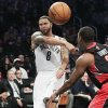 Brooklyn Nets\' Deron Williams (8) passes away from Toronto Raptors\' Kyle Lowry (3) during the first half of an NBA basketball game, Saturday, Nov. 3, 2012, in New York. (AP Photo/Frank Franklin II)