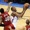 Oklahoma City\'s Kevin Durant (35) moves to the hoop between Miami\'s Udonis Haslem (40) and Shane Battier (31) in the fourth quarter during Game 1 of the NBA Finals between the Oklahoma City Thunder and the Miami Heat at Chesapeake Energy Arena in Oklahoma City, Tuesday, June 12, 2012. Oklahoma City won, 105-94. Photo by Nate Billings, The Oklahoman