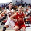 Dale\'s Breck Clark, right, tries to drive past Taylor McAreavey as the Tonkawa Lady Bucs play the Dale Lady Pirates in class 2A State Playoff girls basketball at Westmoore High School on Thursday, March 7, 2013, in Moore, Okla. Photo by Steve Sisney, The Oklahoman