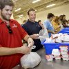 New England Patriots\' wide receiver Wes Welker, right, helps load food sacks along with the help of singer Graham Colton at the Regional Food Bank of Oklahoma on Friday, Sept 26, 2008, in Oklahoma City, Okla. by Chris Landsberger, The Oklahoman