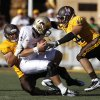 Wyoming defensive end Korey Jones, left, and teammate Josh Biezuns sack Texas State quarterback Tyler Arndt during an NCAA football game Saturday, Sept. 10, 2011, at War Memorial Stadium in Laramie, Wyo. (AP Photo/Laramie Boomerang, Andy Carpenean) ORG XMIT: WYLAR101