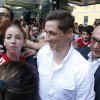 Photo - Spanish striker Fernando Torres, center, is surrounded by AC Milan supporter as he arrives at the