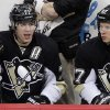Photo -   Pittsburgh Penguins' Evgeni Malkin (71) and Sidney Crosby (87) sit on the bench during the third period of an NHL hockey game against the Philadelphia Flyers in Pittsburgh Saturday, April 7, 2012. The Penguins won 4-2. (AP Photo/Gene J. Puskar)