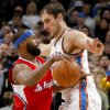 Oklahoma City\'s Nenad Krstic (12) defends Los Angeles\' Baron Davis (5) during the NBA basketball game between the Oklahoma City Thunder and the Los Angeles Clippers at the Oklahoma CIty Arena, Tuesday, Feb. 22, 2011. Photo by Bryan Terry, The Oklahoman