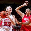 Nebraska\'s Emily Cady, left, moves past Ohio State\'s Ashley Adams, middle, and Raven Ferguson, right, in the second half of an NCAA college basketball game Sunday, Feb. 26, 2012, in Lincoln, Neb. Nebraska won 71-57. (AP Photo/Omaha World-Herald, Anna Reed) MAGS OUT TV OUT NEBRASKA LOCAL BROADCAST OUT
