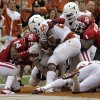 OU\'s Aaron Colvin (14) and OU\'s Tony Jefferson (1) get a safety on Joe Bergeron (24) during the Red River Rivalry college football game between the University of Oklahoma (OU) and the University of Texas (UT) at the Cotton Bowl in Dallas, Saturday, Oct. 13, 2012. Photo by Chris Landsberger, The Oklahoman
