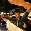 Photo - Soccer fans celebrate with a mock World Cup trophy in Duesseldorf, western Germany, Tuesday evening, July 8, 2014, after Germany beat Brazil 7-1 in their semifinal soccer match of the 2014 World Cup in Brazil. (AP Photo/dpa, Matthias Balk)