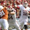 Oklahoma\'s Landry Jones (12) passes the ball against Texas during the Red River Rivalry college football game between the University of Oklahoma Sooners (OU) and the University of Texas Longhorns (UT) at the Cotton Bowl in Dallas, Saturday, Oct. 8, 2011. Photo by Chris Landsberger, The Oklahoman