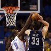 Oklahoma City\'s Serge Ibaka (9) blocks the shot of Memphis\' Marc Gasol (33) during the NBA basketball game between the Oklahoma City Thunder and the Memphis Grizzlies at the Chesapeake Energy Arena in Oklahoma City, Thursday, Jan. 31, 2013.Photo by Sarah Phipps, The Oklahoman