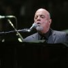 Photo - Billy Joel performs the first show of his Madison Square Garden residency, on Monday, January 27, 2014, in New York. (Photo by Greg Allen/Invision/AP)