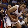 Atlanta Hawk\'s Devin Harris (34) reaches around Oklahoma City Thunder\'s Kevin Martin (23) as the Oklahoma City Thunder play the Atlanta Hawks in NBA basketball at the Chesapeake Energy Arena in Oklahoma City, on Sunday, Nov. 4, 2012. Photo by Steve Sisney, The Oklahoman