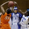 Duke\'s Elizabeth Williams (1) blocks Oklahoma State\'s LaShawn Jones (55) during the first half of a second-round game in the women\'s NCAA college basketball tournament in Durham, N.C., Tuesday, March 26, 2013. (AP Photo/Gerry Broome)