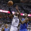 Memphis Grizzlies guard Mike Conley (11) shoots against Oklahoma City Thunder forward Kevin Durant (35) during the first half of Game 4 of a second-round NBA basketball playoff series on Monday, May 9, 2011, in Memphis, Tenn. At left is Thunder guard Russell Westbrook (0). (AP Photo/Wade Payne)