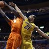 Illinois\' Sam McLaurin, left, tries to get off a shot as Missouri\'s Laurence Bowers defends during the first half of an NCAA college basketball game Saturday, Dec. 22, 2012, in St. Louis. (AP Photo/Jeff Roberson)