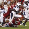 David King (90) causes a fumble by Diondre Borel (12) during the first half of the college football game between the University of Oklahoma Sooners (OU) and Utah State University Aggies (USU) at the Gaylord Family-Oklahoma Memorial Stadium on Saturday, Sept. 4, 2010, in Norman, Okla. Photo by Steve Sisney, The Oklahoman