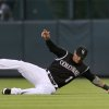 Colorado Rockies rightfielder Brandon Barnes pulls in fly ball off the bat of Miami Marlins\' Casey McGehee in the fifth inning of a baseball game in Denver on Saturday, Aug. 23, 2014. (AP Photo/David Zalubowski)