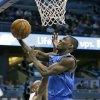 Dallas Mavericks\' Darren Collison, right, drives to the basket past Orlando Magic\'s Arron Afflalo, left, during the first half of an NBA basketball game, Sunday, Jan. 20, 2013, in Orlando, Fla. (AP Photo/John Raoux)