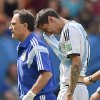 Photo - Argentina's Angel di Maria, right, leaves the field with an injury during the World Cup quarterfinal soccer match between Argentina and Belgium at the Estadio Nacional in Brasilia, Brazil, Saturday, July 5, 2014. (AP Photo/Martin Meissner)