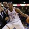 Oklahoma City\'s Kevin Durant (35) tries to get past Sacramento\'s Travis Outlaw (25) during an NBA game between the Oklahoma City Thunder and the Sacramento Kings at Chesapeake Energy Arena in Oklahoma City, Friday, March 28, 2014. Photo by Bryan Terry, The Oklahoman