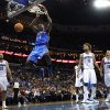 Photo - Oklahoma City Thunder center Kendrick Perkins (5) slam dunk in front of New Orleans Hornets forward Ryan Anderson (33), forward Al-Farouq Aminu (0), guard Greivis Vasquez (21) and center Robin Lopez (15) in the first half of an NBA basketball game in New Orleans, Saturday, Dec. 1, 2012. (AP Photo/Gerald Herbert)
