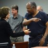 O.J. Simpson, right, talks to his defense attorney Patricia Palm during a break in the second day of an evidentiary hearing in Clark County District Court, Tuesday, May 14, 2013 in Las Vegas. The hearing is aimed at proving Simpson\'s trial lawyer, Yale Galanter, had conflicted interests and shouldn\'t have handled Simpson\'s case. Simpson is serving nine to 33 years in prison for his 2008 conviction in the armed robbery of two sports memorabilia dealers in a Las Vegas hotel room. Judge Linda Marie Bell let Simpson have one hand unshackled to drink water and take notes. His left hand was still cuffed to the arm of his chair during the hearing. (AP Photo/Ethan Miller, Pool)