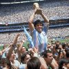 Photo - FILE - In this June 29, 1986, file photo, Diego Maradona, holds up the trophy, after Argentina beat West Germany 3-2 in their World Cup soccer final match, at the Atzeca Stadium, in Mexico City. On Sunday, July 13, 2014, Germany and Argentina will face each other again in the final of the 2014 soccer World Cup.(AP Photo/Carlo Fumagalli, File)