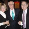 Diana and Jeff Beeler and Dick Homsey celebrate the upcoming wedding. (Photo by Helen Ford Wallace).
