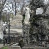 This April 10, 2013 photo shows a statue decorating a grave at the Bellu cemetery in Bucharest, Romania. It was founded by a shepherd, according to local legend, and was later nicknamed the Paris of the East. But Bucharest\'s idyllic roots and elegant reputation eventually gave way to a series of 20th century calamities: war, invasions, earthquakes and communism.(AP Photo/Vadim Ghirda)