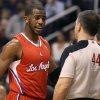 Los Angeles Clippers\' Chris Paul, left, discusses a non-call against the Phoenix Suns with official Eli Roe during the first half of an NBA basketball game Sunday, Dec. 23, 2012, in Phoenix. (AP Photo/Ralph Freso)
