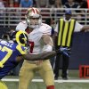San Francisco 49ers quarterback Colin Kaepernick, right, tries to toss the ball to teammate Ted Ginn as St. Louis Rams\' Quintin Mikell (27) defends during the second half of an NFL football game on Sunday, Dec. 2, 2012, in St. Louis. The play was ruled a fumble, recovered by Rams\' Janoris Jenkins who took it in for a touchdown. (AP Photo/Seth Perlman)