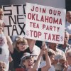 Picket sign in hand, Anne Burnett of Del City cheered a speaker at an anti-tax rally at the state Capitol. About 200 supporters of STOP New Taxes participated in the July 16, 1990, rally. [Photo by Jim Beckel, The Oklahoman Archives]