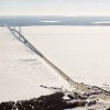 Photo - FILE - In this Feb. 11, 2014 aerial file photo is a view of The Mackinac Bridge which spans a 5-mile-wide freshwater channel that separates Michigan's upper and lower peninsulas. Michigan's attorney general and chief environmental regulator have asked the company that owns two oil pipelines stretched beneath the straits, an ecologically sensitive area of the Great Lakes, for evidence that the 61-year-old lines are properly maintained and in good condition. (AP Photo/ Traverse City Record-Eagle, Keith King, Pool)