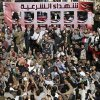 Muslim Brotherhood and Egyptian President Morsi supporters chant slogans during the funeral of three victims who were killed during Wednesday\'s clashes outside Al-Azhar mosque, the highest Islamic Sunni institution, Friday, Dec. 7, 2012. During the funeral, thousands Islamist mourners chanted,