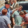 Tornado damage tour: President Bill Clinton in a Midwest City Police cap and with his arm on the shoulders of Sherrill Evett and her grandson Jeremy Walker laughs with Evett\'s daughter Tracy Walker as he leaves