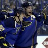 Photo - St. Louis Blues' Alexander Steen, left, is congratulated by teammate David Backes after scoring the game-winning goal during the third overtime in Game 1 of a first-round NHL hockey Stanley Cup playoff series against the Chicago Blackhawks Thursday, April 17, 2014, in St. Louis. The Blues won 4-3 in triple overtime. (AP Photo/Jeff Roberson)