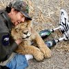 John Reinke, park manager at the G.W. Exotic Animal Park, hugs \'Bonedigger\' an ailing lion that Reinke is trying to nurse back to health in a pen next to Reinke\'s house in the park, Wednesday, Jan. 13, 2010. Photo by Jim Beckel, The Oklahoman