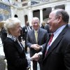 Photo - Detroit Mayor Mike Duggan, right, talks with Carol and Paul Schaap, who donated $5 million to the Detroit Institute of Arts, Wednesday, July 16, 2014. The institute says it has pledges for about 80 percent of the $100 million it promised toward an effort involving the state of Michigan and major foundations to prevent the sale of art and soften cuts to city retirees during Detroit's bankruptcy. It announced nearly $27 million in new donations and grants from prominent businesses Wednesday, including $10 million from billionaire Roger Penske and his Penske Corp. (AP Photo/The Detroit News, Todd McInturf)