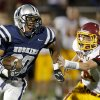 Edmond North\'s Richard Morrison runs past Putnam City North\'s Creighton Decker during a high school football game at Wantland Stadium in Edmond, Okla., Friday, September 21, 2012. Photo by Bryan Terry, The Oklahoman