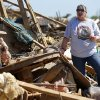 Pam Dennis searches through what is left of her home on Kings Manor in Moore, Okla., Wednesday, May 22, 2013.A tornado damaged the area on Monday, May 20, 2013. Photo by Bryan Terry, The Oklahoman